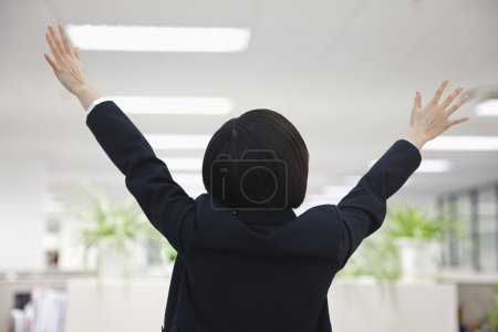 Businesswoman with Arm Raised