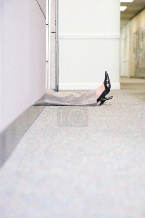 Legs of woman lying on floor