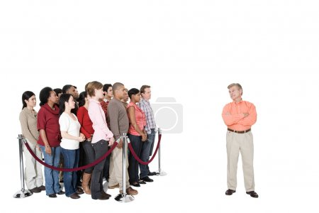 Mature man standing out from the crowd