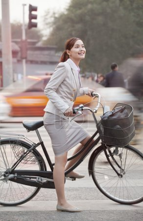 Business Woman commuting with a Bicycle