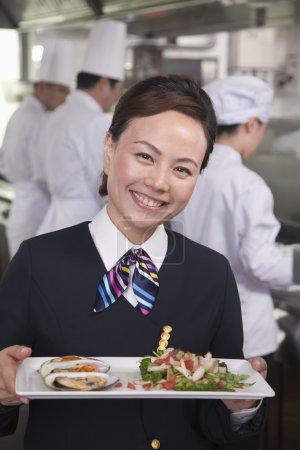 Hostess Presenting Gourmet Dish
