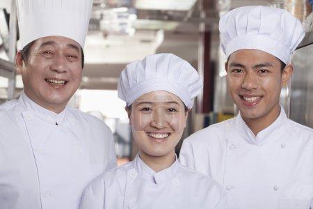 Chefs in an Industrial Kitchen