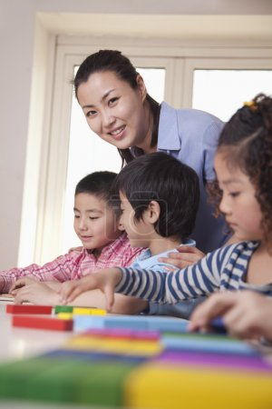 Teacher Helping Her Students