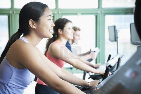 Women exercising on fitness bikes