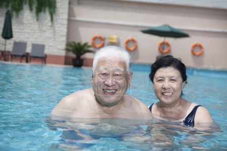 Senior couple relaxing in the pool