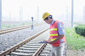 Railroad worker checking the railroad tracks
