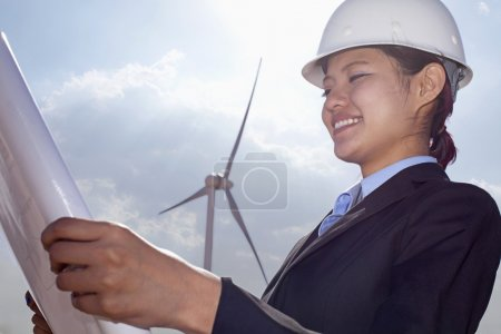 Engineer looking down at blueprints