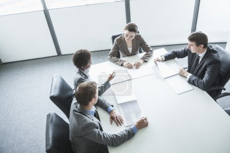 Four business people having a business meeting