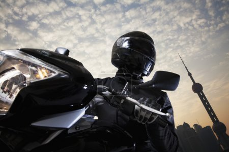 Man riding a motorcycle during the day