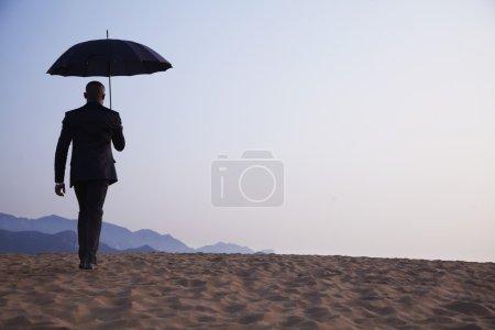 Businessman holding an umbrella