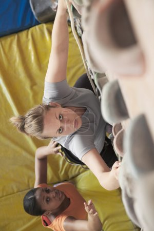 Women climbing in an indoor climbing gym