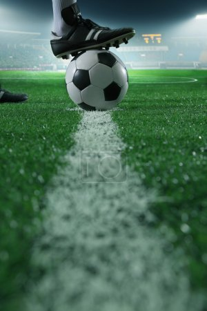 Photo for Close up of foot on top of soccer ball on the line - Royalty Free Image