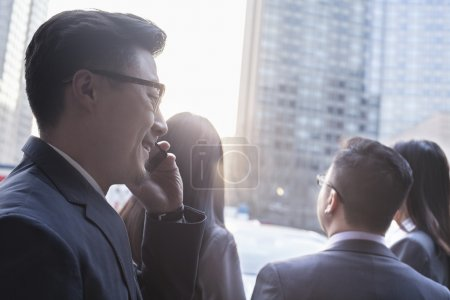 Businessman on the phone with colleagues
