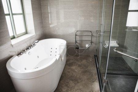 Modern, clean, bathroom with bathtub and shower