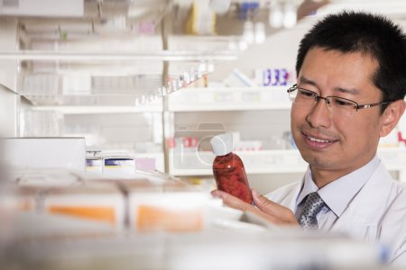 Pharmacist examining prescription medication