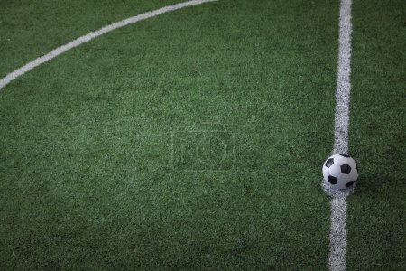 Photo for Soccer field with soccer ball on the line, high angle view - Royalty Free Image
