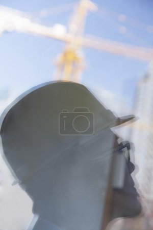 Reflection of architect on construction site