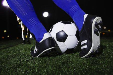Feet kicking the soccer ball