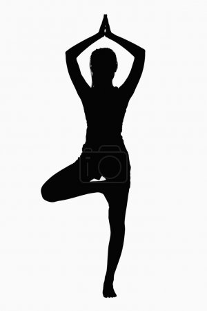 Silhouette of woman doing yoga pose