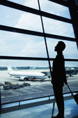 Silhouette of businessman waiting in the airport
