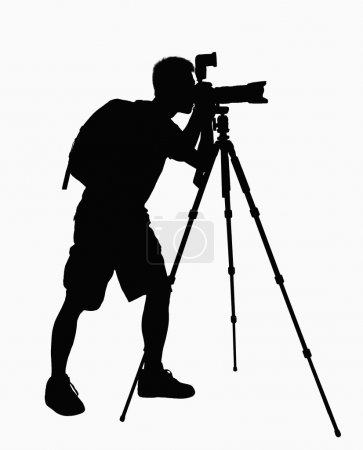 Silhouette of man taking pictures with camera