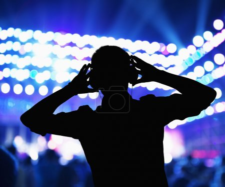 Silhouette of DJ wearing headphones