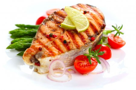 Salmon steak on grilled vegetables