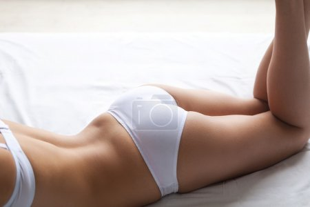 Woman in white lingerie lying