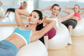 Women training their abs.