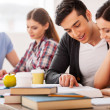 Confident students. Four cheerful students studyin...
