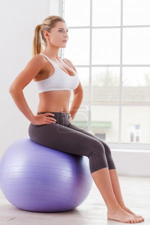Exercising with fitness ball.