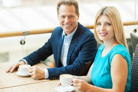 Couple drinking coffee in coffee shop
