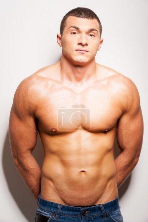 Strong and muscular shirtless man
