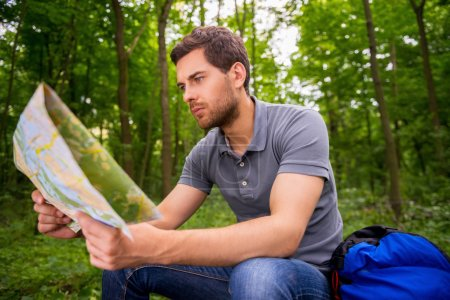 Young man with examining map
