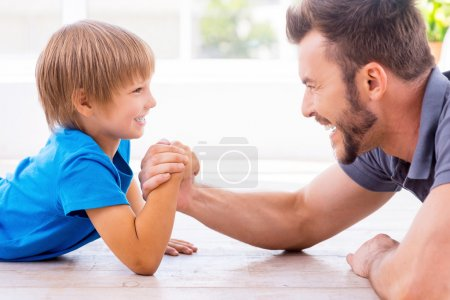 Father and son competing in arm wrestling