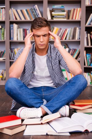 Frustrated young man touching his head