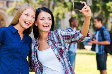 Beautiful young women making selfie
