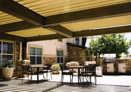Covered hotel patio with tables