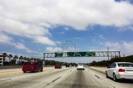 Traffic signs pointing directions to Los Angeles o...