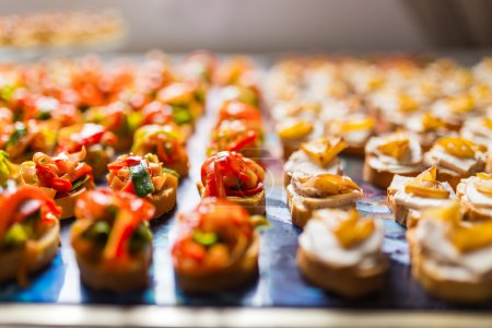 Photo for Rows of delicious canapes placed on a tray - Royalty Free Image