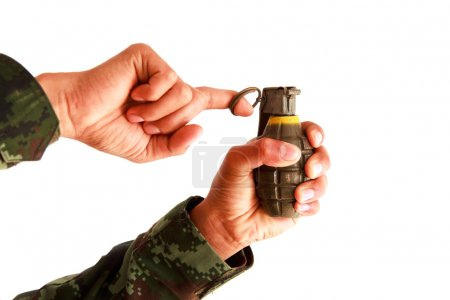 Military hand grenade throwing, pulling on a white...