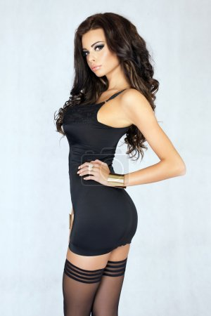 Sexy brunette woman looking at camera, posing.
