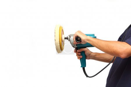 Man holds the Machine polisher for car care
