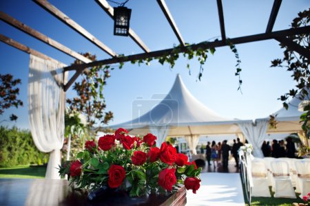 Photo for Beautiful ceremony venue with flowers and blue sky - Royalty Free Image