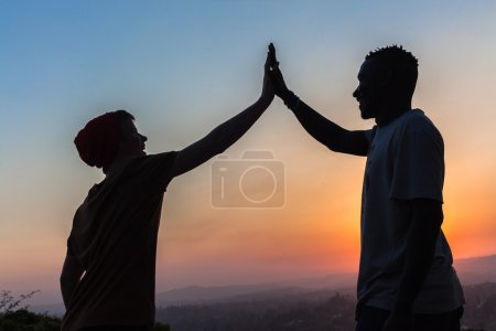 Friends High Five Hands Contrasts Silhouetted