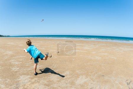 Boy Throws Boomerang Beach Sea