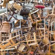 Hundreds of vintage chairs stacked in a pile...
