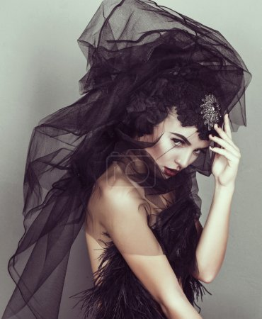 Beautiful model with black veil