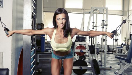 Photo for Woman with sportive body making sport at gym - Royalty Free Image