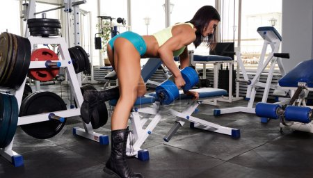 Sexy sportive woman making sport at gym